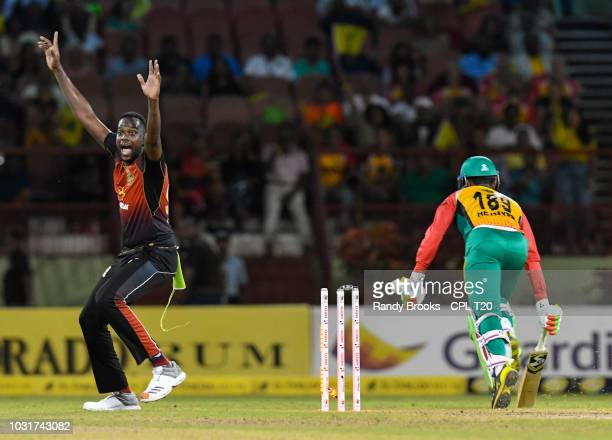 In this handout image provided by CPL T20 Kevon Cooper of Trinbago Knight Riders celebrates the dismissal of Shimron Hetmyer of Guyana Amazon...