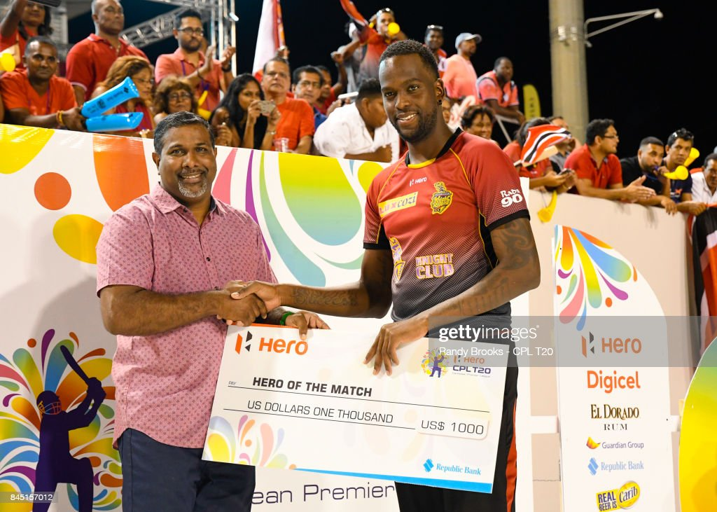 In this handout image provided by CPL T20, Kevon Cooper (R) of Trinbago Knight Riders receives from after the Finals of the 2017 Hero Caribbean Premier League between Trinbago Knight Riders and St Kitts & Nevis Patriots at Brian Lara Cricket Academy on September 09, 2017 in Tarouba, Trinidad.