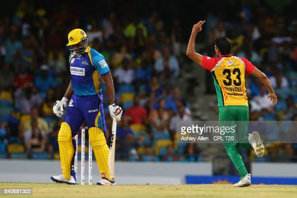In this handout image provided by CPL T20 Kieron Pollard captain of Barbados Tridents is dismissed for 0 as Sohail Tanvir of the Guyana Amazon...