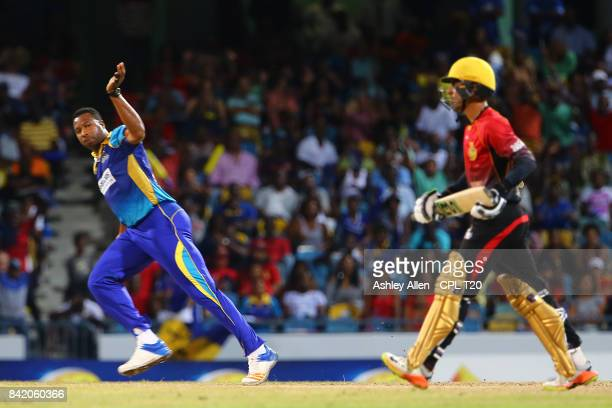 In this handout image provided by CPL T20 Kieron Pollard captain of Barbados Tridents celebrates the dismissal of Shadab Khan of the Trinbago Knight...