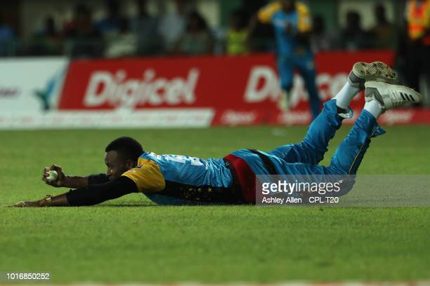 In this handout image provided by CPL T20 Kieron Pollard of St Lucia Stars completes a catch during the Hero Caribbean Premier League match between...