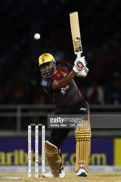 In this handout image provided by CPL T20 Kieron Pollard of Trinbago Knight Riders hits four during the Hero Caribbean Premier League match between...