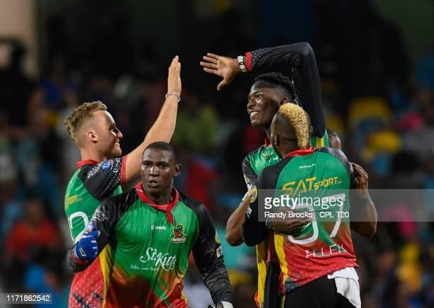 In this handout image provided by CPL T20, Laurie Evans , Devon Thomas and Domnic Drakes of St Kitts Nevis and Patriots celebrate winning match 25 of...