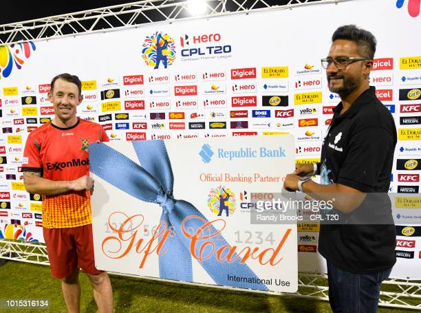 In this handout image provided by CPL T20 Luke Ronchi of Guyana Amazon Warriors receives the Republic Bank gift card during match 4 of the Hero...