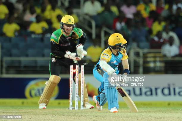 In this handout image provided by CPL T20 Mark Chapman of St Lucia Stars is bowled during the Hero Caribbean Premier League match between Jamaica...