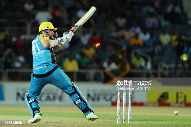 In this handout image provided by CPL T20 Mitchell McClenaghan of St Lucia Stars is bowled by Oshane Thomas during the Hero Caribbean Premier League...
