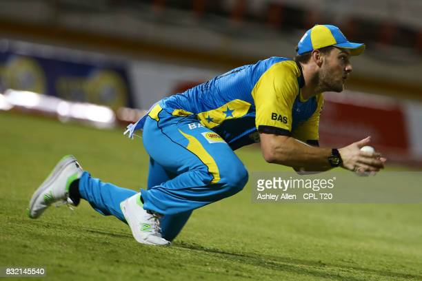 In this handout image provided by CPL T20 Mitchell McClenaghan of St Lucia Stars catches Kumar Sangakarra of the Jamaica Tallawahs during Match 14 of...