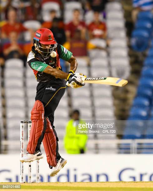 In this handout image provided by CPL T20 Mohammad Hafeez of St Kitts Nevis Patriots hit on the helmet during the Play Off Match of the 2017 Hero...