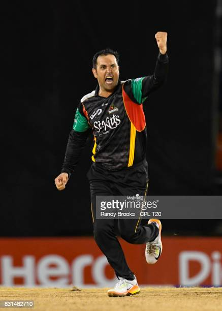 In this handout image provided by CPL T20 Mohammed Nabi of St Kitts Nevis Patriots celebrates the dismissal of Darren Bravo of Trinbago Knight Riders...