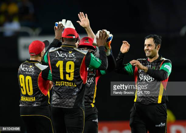 In this handout image provided by CPL T20 Mohammed Nabi of St Kitts Nevis Patriots celebrates the dismissal of Glen Phillip of Jamaica Tallawahs...