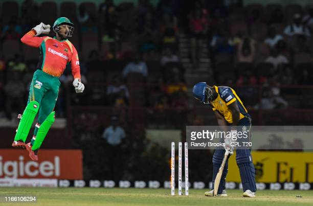 In this handout image provided by CPL T20 Nicholas Pooran of Guyana Amazon Warriors celebrates the dismissal of Andre Fletcher of St Lucia Zouks...