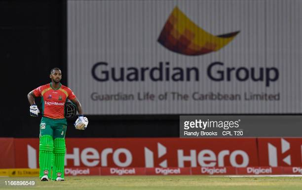 In this handout image provided by CPL T20, Nicholas Pooran of Guyana Amazon Warriors waiting to walk off the field during match 6 of the Hero...