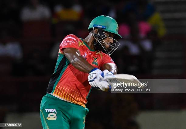 In this handout image provided by CPL T20, Nicholas Pooran of Guyana Amazon Warriors hits 4 during match 30 of the Hero Caribbean Premier League...