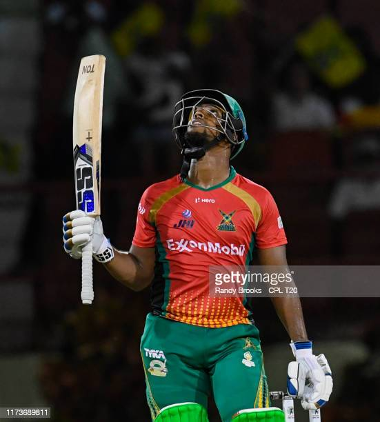 In this handout image provided by CPL T20, Nicholas Pooran of Guyana Amazon Warriors celebrates his half century during match 30 of the Hero...