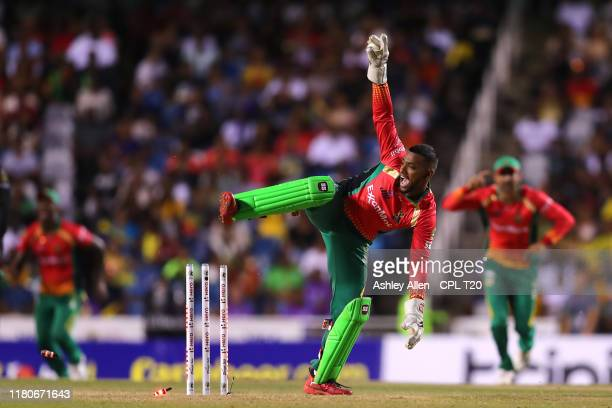 In this handout image provided by CPL T20, Nicholas Pooran of Guyana Amazon Warriors appeals for the runout of Jason Holder of Barbados Tridents...