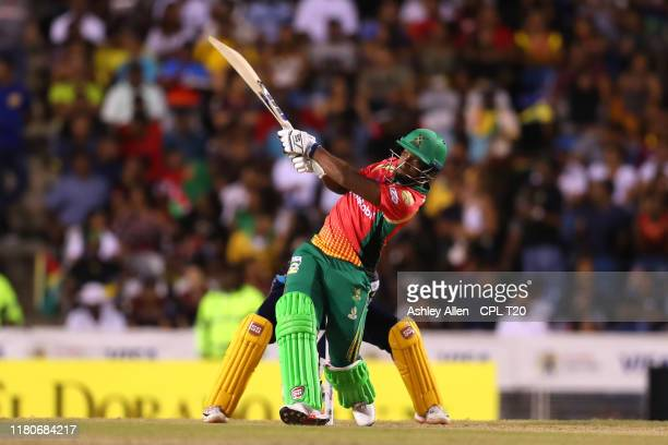 In this handout image provided by CPL T20, Nicholas Pooran of Guyana Amazon Warriors hits six during the Hero Caribbean Premier League Final between...
