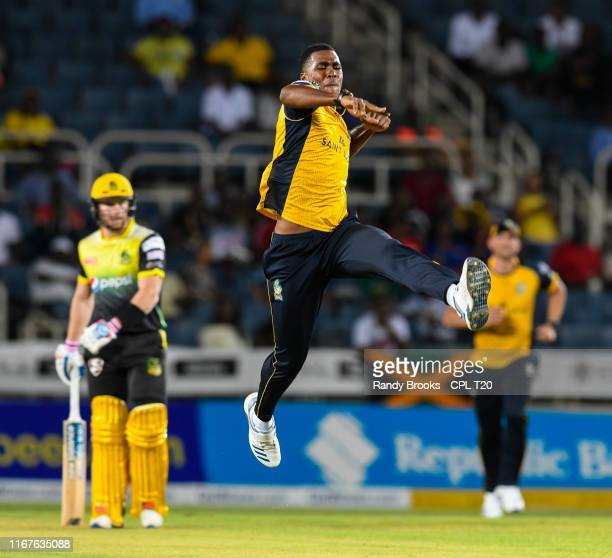 In this handout image provided by CPL T20, Obed McCoy of St Lucia Zouks celebrates the dismissal of Chris Gayle of Jamaica Tallawahs during match 9...