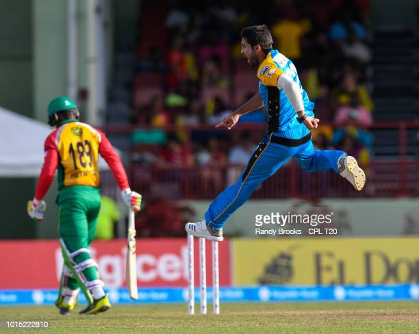 In this handout image provided by CPL T20 Qais Ahmad of St Lucia Stars celebrates the dismissal of Shimron Hetmyer of Guyana Amazon Warriors during...