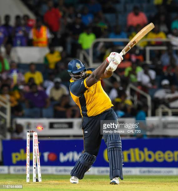 In this handout image provided by CPL T20, Rahkeem Cornwall of of St Lucia Zouks bowled by Shamar Springer of Jamaica Tallawahs during match 9 of the...
