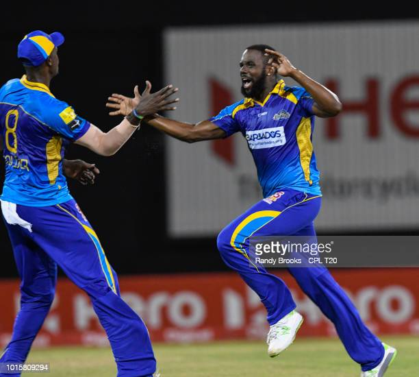 In this handout image provided by CPL T20 Raymon Reifer of Barbados Tridents celebrates the dismissal of Shimron Hetmyer of Guyana Amazon Warriors...