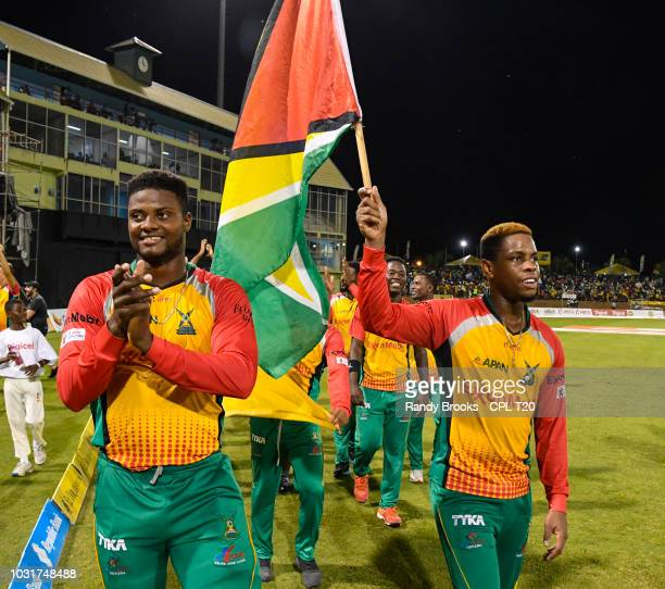 In this handout image provided by CPL T20 Romario Shepherd and Shimron Hetmyer of Guyana Amazon Warriors wave to fans at the end of the Hero...