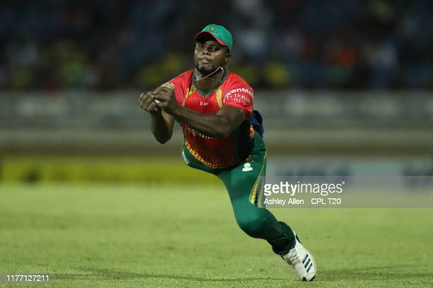In this handout image provided by CPL T20 Romario Shepherd of Guyana Amazon Warriors completes a catch during the Hero Caribbean Premier League match...