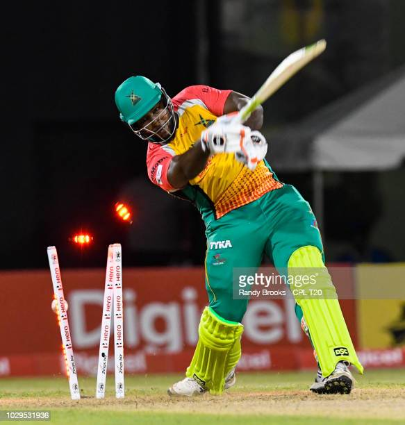 In this handout image provided by CPL T20 Roshan Primus of Guyana Amazon Warriors bowled by Rovman Powell of Jamaica Tallawahs during match 29 of the...