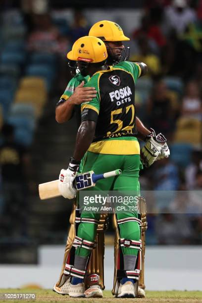 In this handout image provided by CPL T20 Rovman Powell and Colin de Grandhomme of Jamaica Tallawahs celebrate victory during the Hero Caribbean...