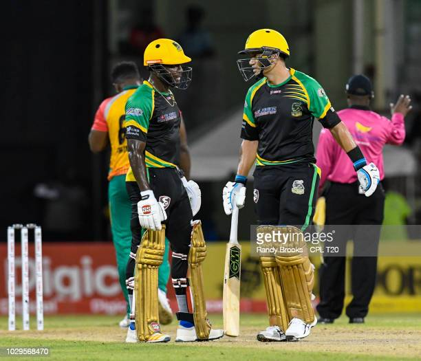In this handout image provided by CPL T20 Rovman Powell and Ross Taylor of Jamaica Tallawahs during match 29 of the Hero Caribbean Premier League...