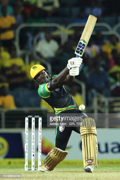 In this handout image provided by CPL T20 Rovman Powell of Jamaica Tallawahs hits a boundary during the Hero Caribbean Premier League match between...