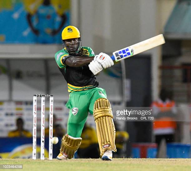 In this handout image provided by CPL T20 Rovman Powell of Jamaica Tallawahs hits 6 during match 17 of the Hero Caribbean Premier League between St...