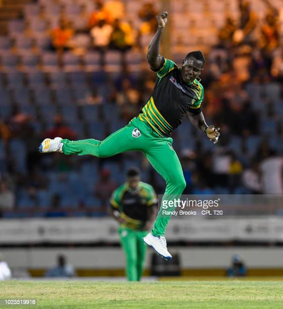 In this handout image provided by CPL T20 Rovman Powell of Jamaica Tallawahs celebrates the dismissal of Andre Fletcher of St Lucia Stars during...