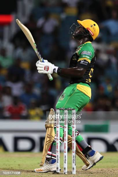 In this handout image provided by CPL T20 Rovman Powell of Jamaica Tallawahs hits six during the Hero Caribbean Premier League match between Barbados...