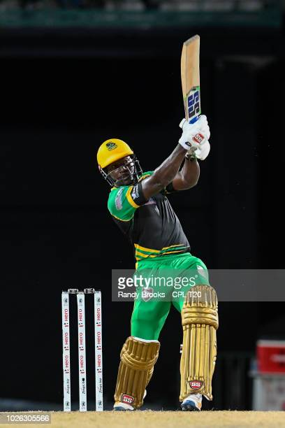 In this handout image provided by CPL T20 Rovman Powell of Jamaica Tallawahs hits 6 during match 25 of the Hero Caribbean Premier League between St...