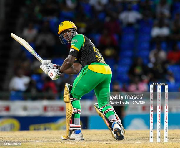 In this handout image provided by CPL T20 Rovman Powell of Jamaica Tallawahs hits 4 during match 25 of the Hero Caribbean Premier League between St...