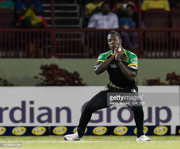 In this handout image provided by CPL T20 Rovman Powell of Jamaica Tallawahs takes the catch to dismiss Luke Ronchi of Guyana Amazon Warriors during...