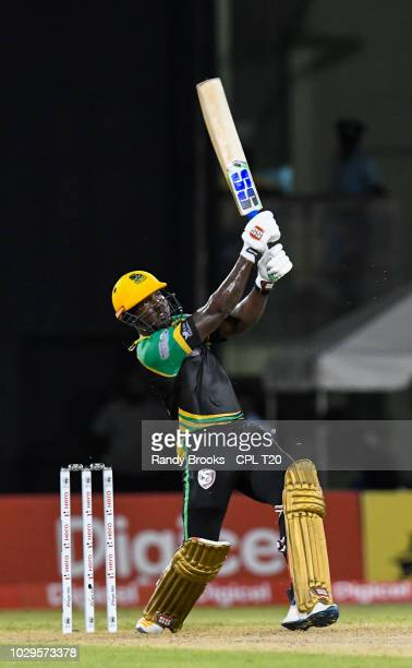 In this handout image provided by CPL T20 Rovman Powell of Jamaica Tallawahs hits 6 during match 29 of the Hero Caribbean Premier League match...