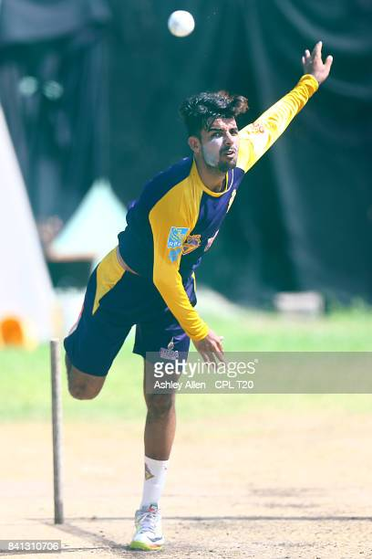 In this handout image provided by CPL T20 Shadab Khan of the Trinbago Knight Riders bowls during a training session at Kensington Oval on August 31...