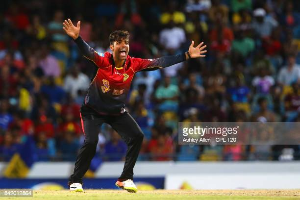 In this handout image provided by CPL T20 Shadab Khan of the Trinbago Knight Riders appeals successfully for the wicket of Christopher Barnwell...