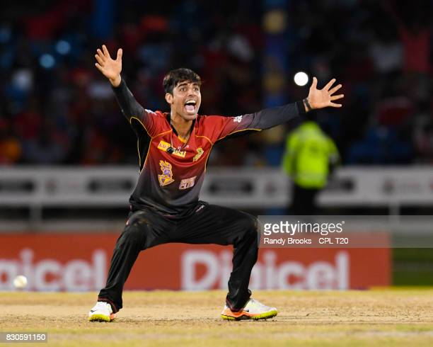 In this handout image provided by CPL T20 Shadab Khan of Trinbago Knight Riders celebrates taking 4 Guyana Amazon Warriorswicket for 28 runs during...