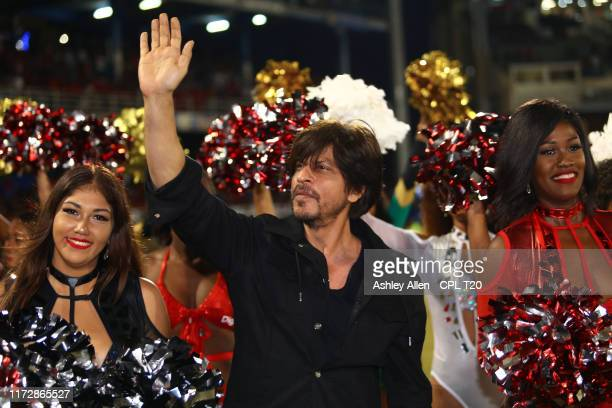 In this handout image provided by CPL T20 Shah Rukh Khan owner of Trinbago Knight Riders greets the crowd during the Hero Caribbean Premier League...
