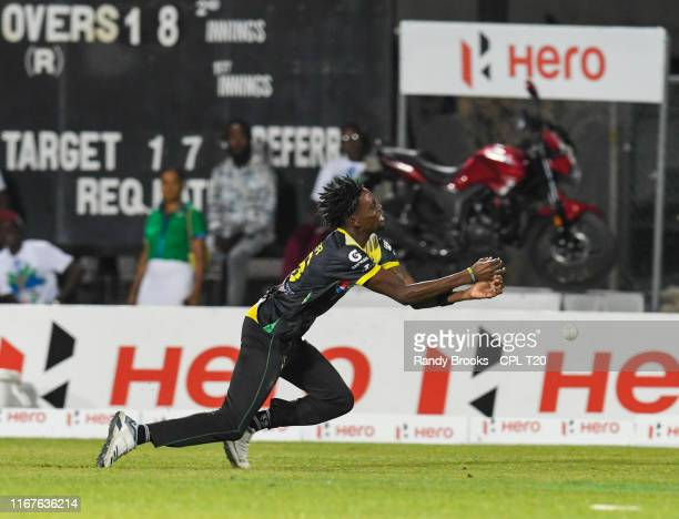 In this handout image provided by CPL T20, Shamar Springer of Jamaica Tallawahs drops Andre Fletcher of St Lucia Zouks during match 9 of the Hero...