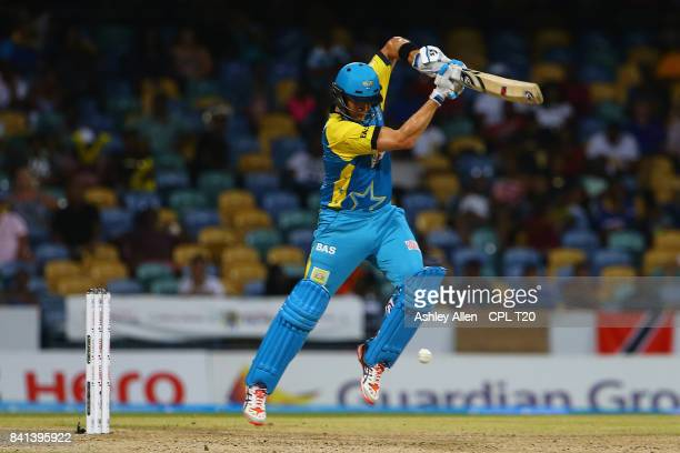 In this handout image provided by CPL T20 Shane Watson of the St Lucia Stars plays a lifting delivery during Match 25 of the 2017 Hero Caribbean...
