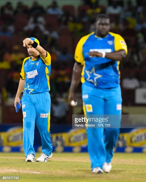 In this handout image provided by CPL T20 Shane Watson sets the field for Rahkeem Cornwall of St Lucia Stars during Match 21 of the 2017 Hero...