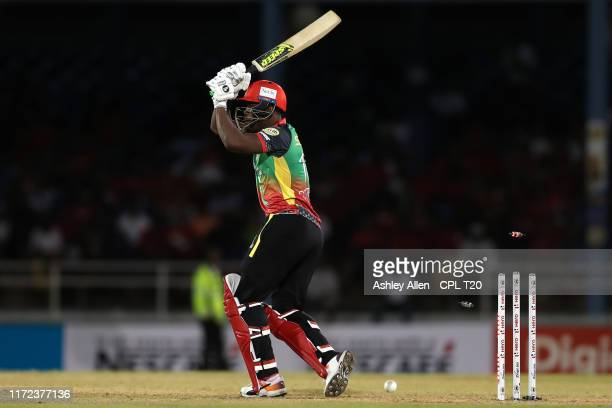In this handout image provided by CPL T20, Sheldon Cottrell of St Kitts and Nevis Patriots is bowled by Jimmy Neesham of Trinbago Knight Riders...