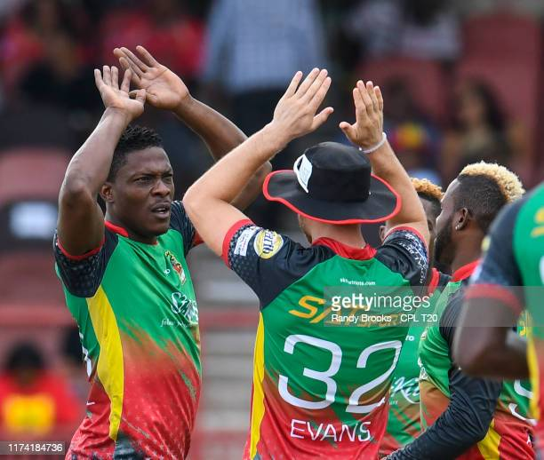 In this handout image provided by CPL T20, Sheldon Cottrell of St Kitts and Nevis Patriots celebrates the dismissal of Colin Munro of Trinbago Knight...