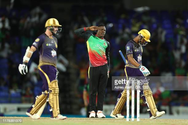 In this handout image provided by CPL T20, Sheldon Cottrell of St Kitts and Nevis Patriots picks up the wicket of Lendl Simmons of Trinbago Knight...