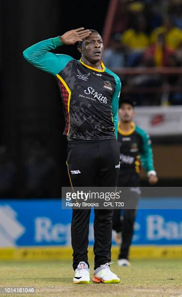 In this handout image provided by CPL T20, Sheldon Cottrell of St Kitts & Nevis Patriots celebrates the dismissal of Shoaib Malik of Guyana Amazon...