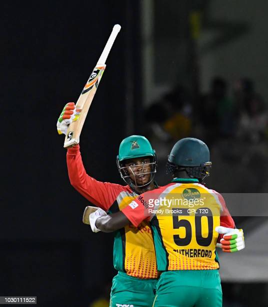 In this handout image provided by CPL T20 Sherfane Rutherford hug Shimron Hetmyer of Guyana Amazon Warriors for reaching 50 during match 30 of the...