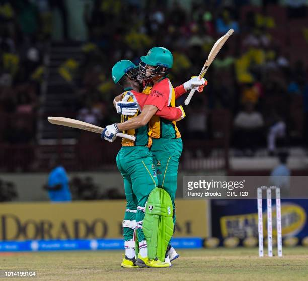 In this handout image provided by CPL T20 Shimron Hetmyer and Chris Green of Guyana Amazon Warriors celebrate winning the Hero Caribbean Premier...